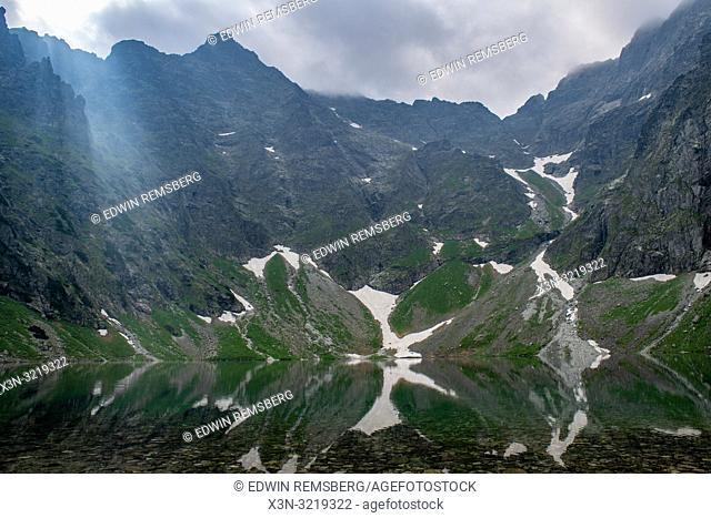 The Tatra Mountains Poland side of Mt. Rysy and Czarny Staw pod Rysami (Black Lake) in the Tatra National Park,Lesser Poland Vovoidship, Poland