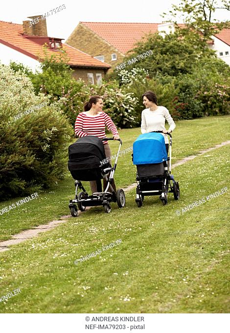 Women walking with baby carriages, Sweden