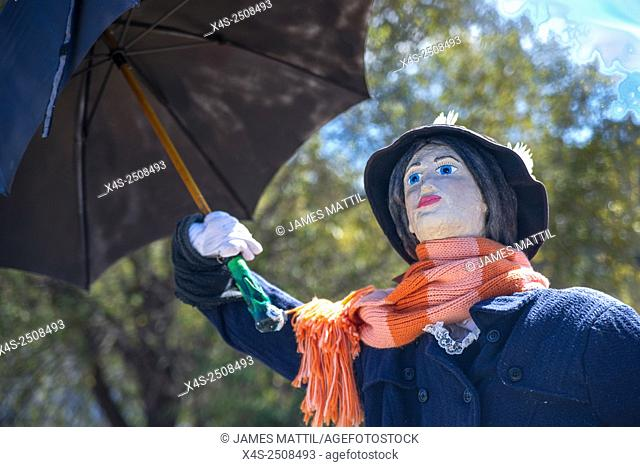 A homemade scarecrow depicting story book character Mary Poppins at a Halloween festival