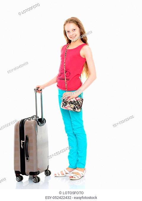 A beautiful little girl with a large suitcase prepared for the journey. Isolated on white background