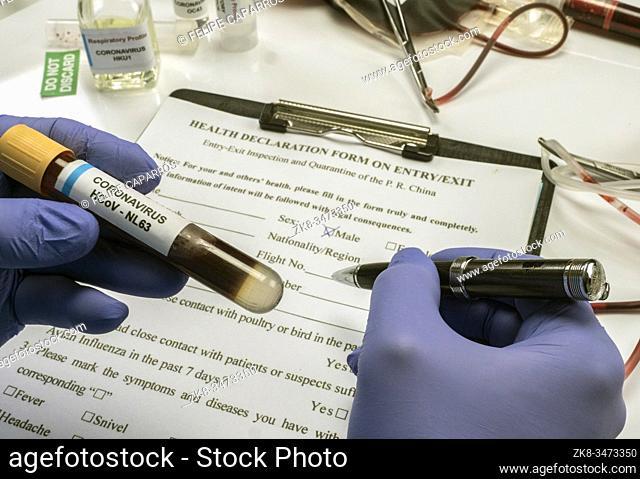 Scientist examines sample of coronavirus in laboratory, conceptual image