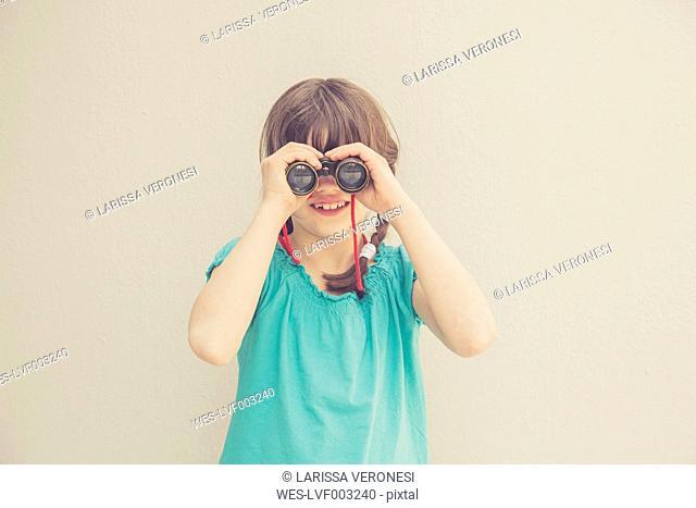 Girl looking through binocular