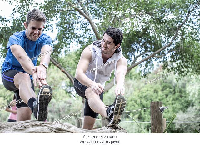 Two young men excercising together