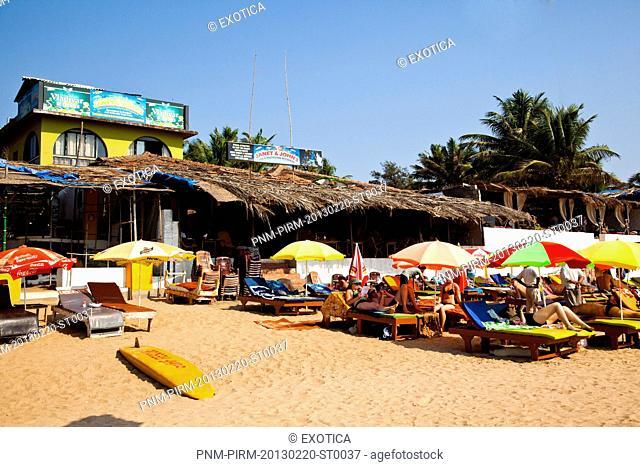 Tourists at a restaurant on the beach, Janet and John's, Goenkar Vaddo, Mid Anjuna Beach, Anjuna, Bardez, North Goa, Goa, India