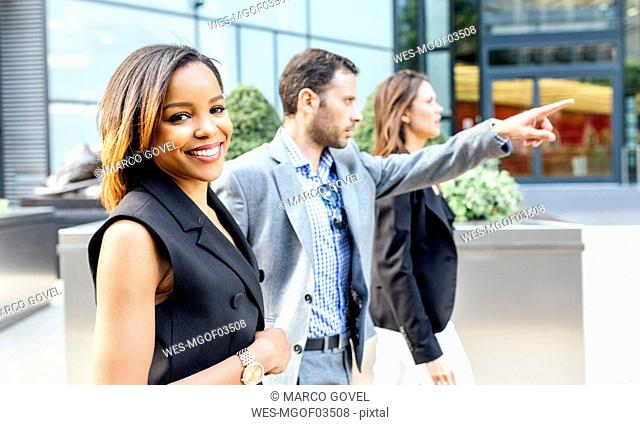 Businesspeople walking through the city