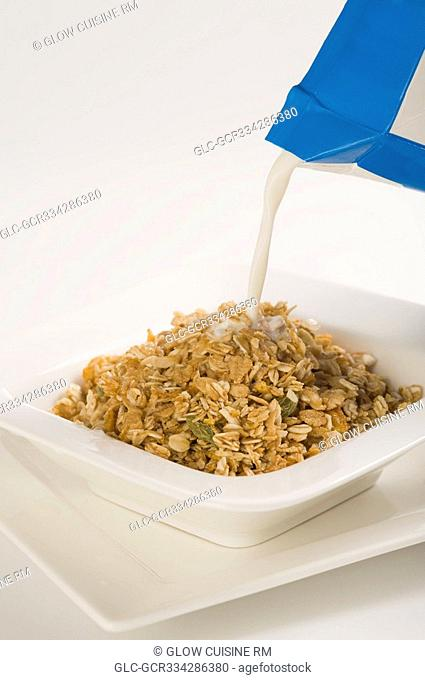 Milk being poured on to breakfast cereal