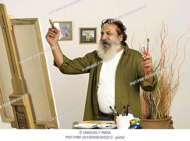 Painter getting excited to look his artwork