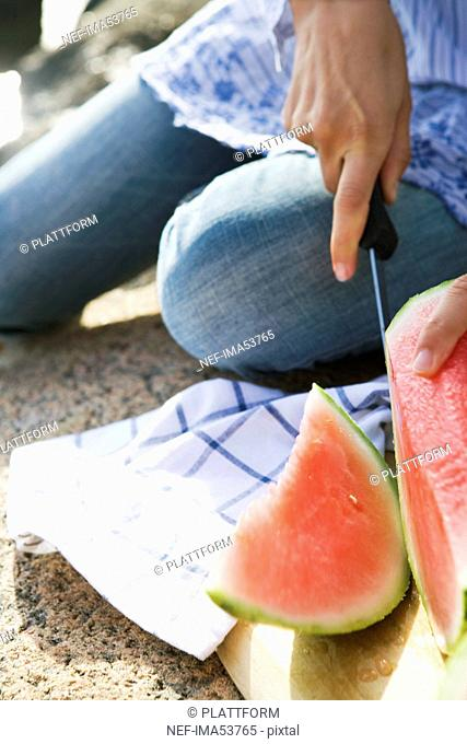 A woman cutting up a watermelon, Sweden