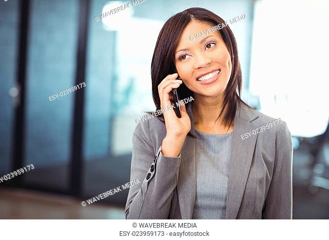 Attractive businesswoman talking on mobile phone