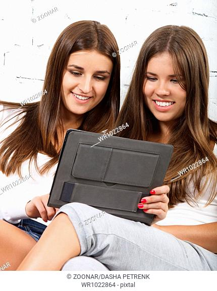 High school student girl using tablet computer