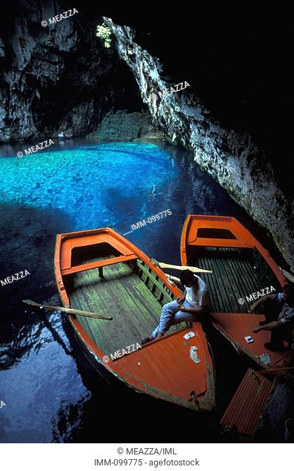 Eptanese, Kefallonia Melissani Cave: outside cave, Man in boat, money
