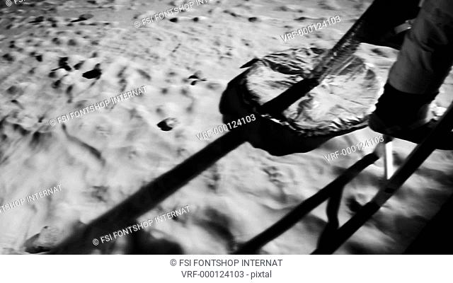 SLO MO, CU, Lockdown, HA, low section of an astronaut climbing down the ladder of a Lunar Lander