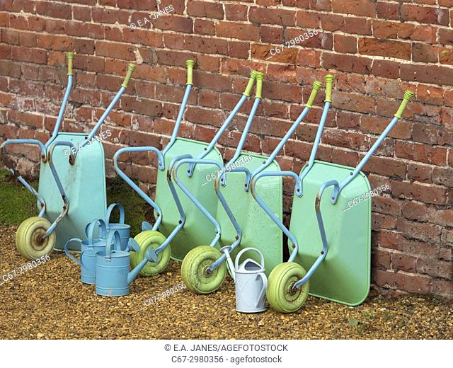 Childrens wheel barrows and watering cans in school gardening project