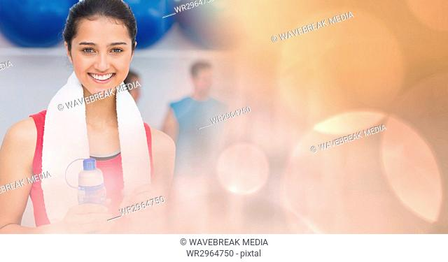 Woman with bottle and towel and peach bokeh transition