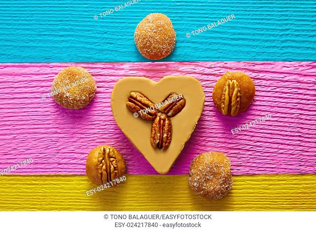 Mexican candy sweets cajeta heart with pecan nuts