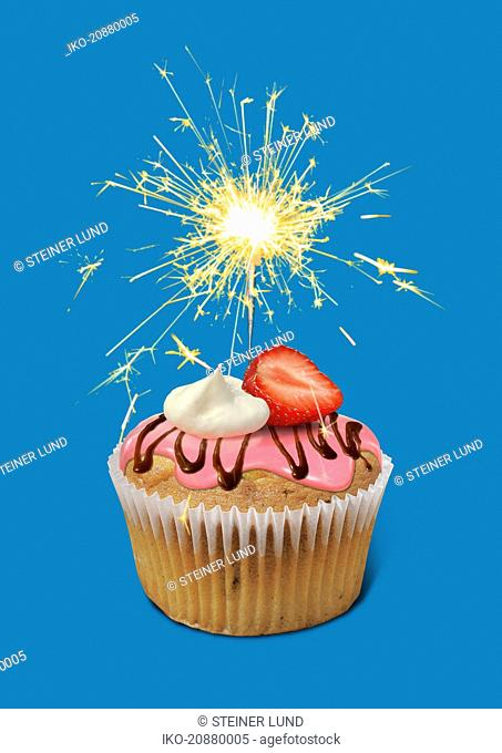 Sparkler burning on top of cupcake