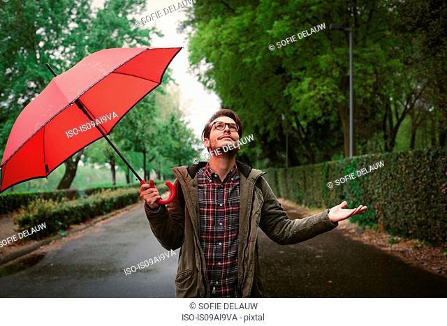 Man checking if rain has stopped