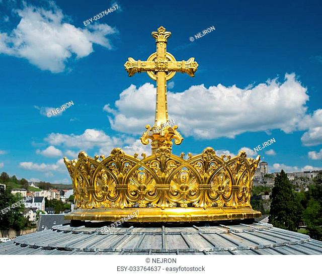 Crown and cross on a dome of the Basilica of Our Lady of the Rosary of Lourdes, France