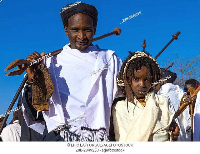 Dabale age grade boy with his father during the Gada system ceremony in Borana tribe, Oromia, Yabelo, Ethiopia