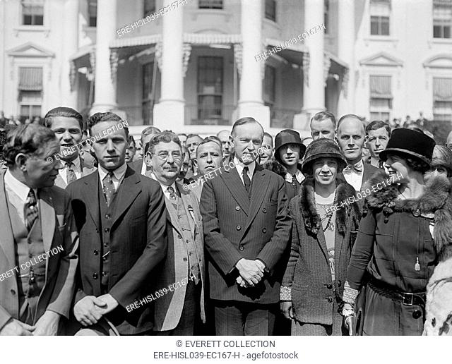President Calvin Coolidge meeting with members of the National Association of Retail Druggists. Sept. 27, 1924. Coolidge observed the traditional 'porch...