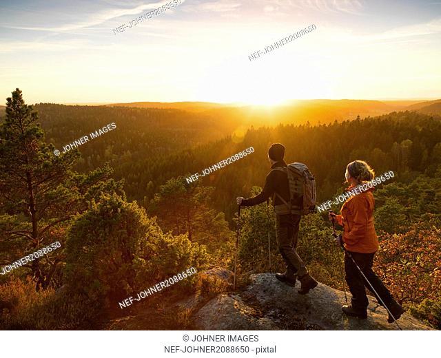 Man and woman hiking at sunset
