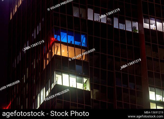 Vienna, office building, lit offices, night, highrise DC Tower 1 in 22. Donaustadt, Wien, Austria