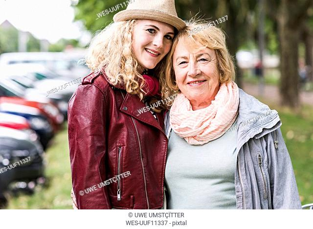 Portrait of happy grandmother and granddaughter head to head