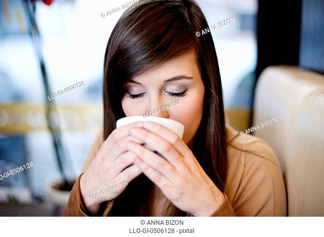 Close-up of woman drinking coffee, Debica, Poland