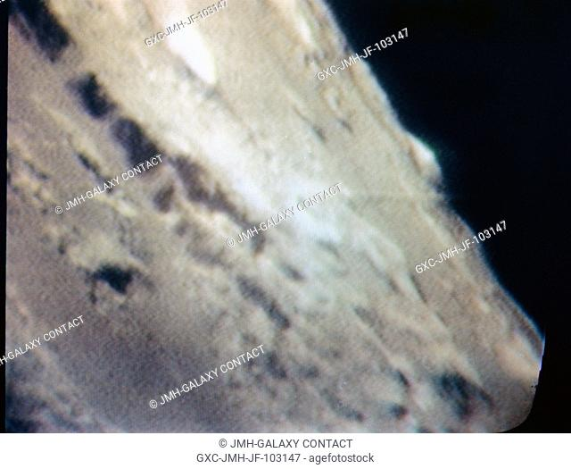 An oblique view of Barbara Mesa on the lunar nearside is seen in this color reproduction taken from a telecast made by the color television camera aboard the...
