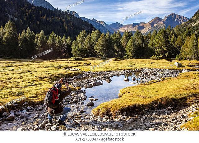 Hiker. Aigüestortes area,Aigüestortes i Estany de Sant Maurici National Park,Pyrenees, Lleida province, Catalonia, Spain