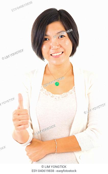 Asian female thumbs up with great smile