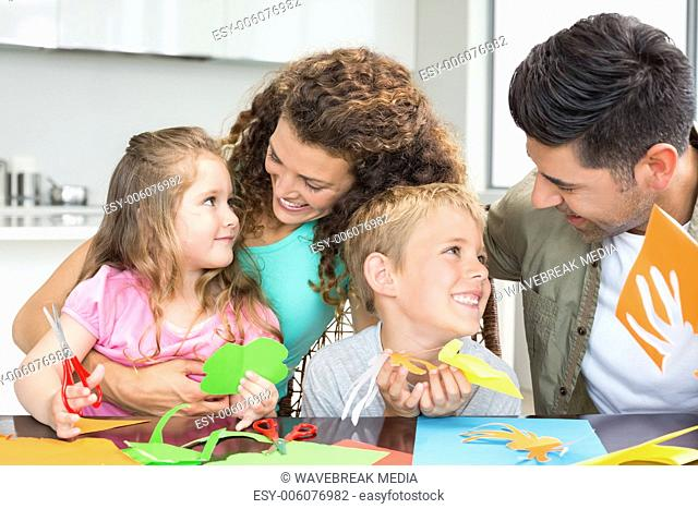 Smiling young family doing arts and crafts at the table