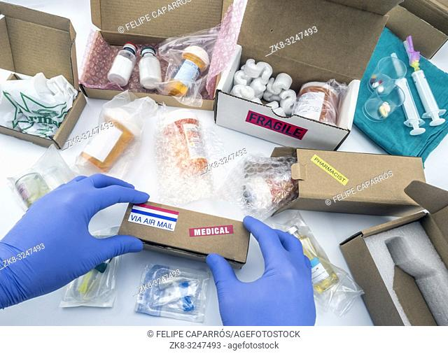 Nurse unpacking medication in boxes, conceptual image, horizontal composition