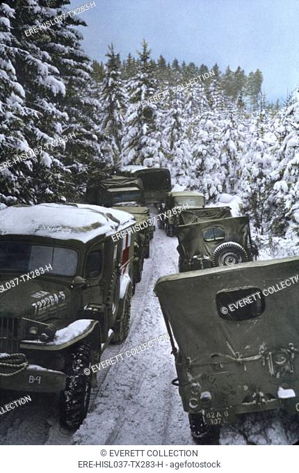 With the Battle of the Bulge ended, U.S. army vehicles advance to the Rhine and Germany. While the battle delayed them for six weeks