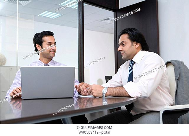 Two businessmen having a meeting