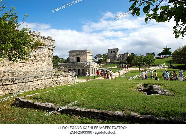 View of the Temple of the Frescos and El Castillo (castle) in Tulum, which is the site of a Pre-Columbian Mayan walled city along the east coast of the Yucatán...