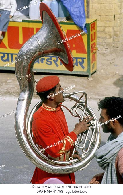 Man playing Tuba kumbh fair ; haridwar ; uttar pradesh ; india