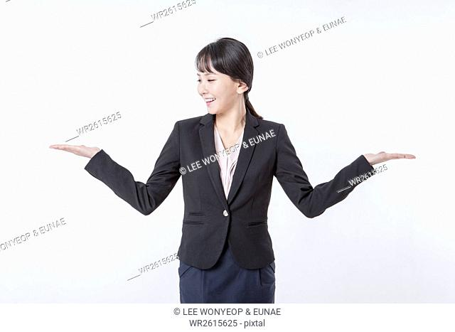 Smiling businesswoman opening arms