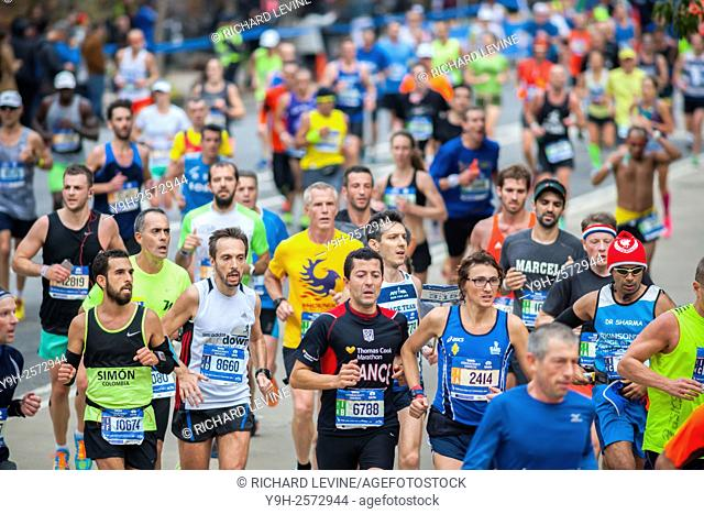 Runners pass through Harlem in New York near the 22 mile mark near Mount Morris Park on Sunday, November 1, 2015 in the 45th annual TCS New York City Marathon
