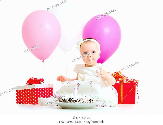 cute kid girl eating birthday cake