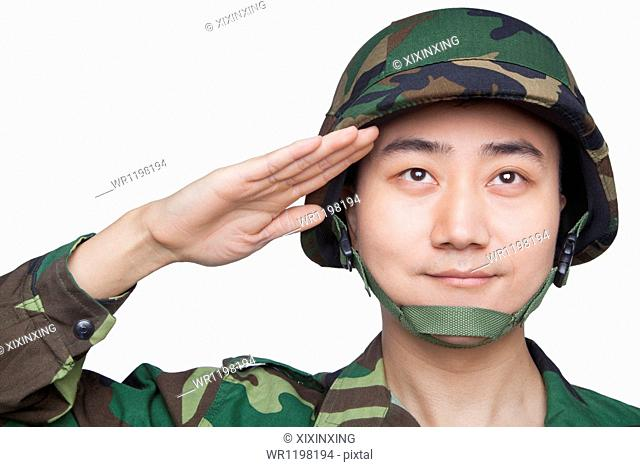 Man in military uniform saluting