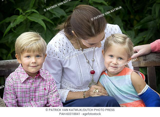 Danish Crown Princess Mary, Pricne Vincent and Princess Josephine during a photo session during their summer holidays at Grasten Slot, Denmark, 25 July 2015