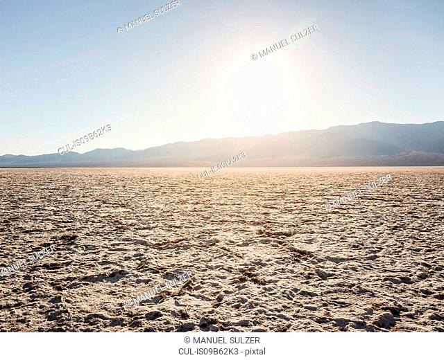 Flat dry mud landscape at Badwater Basin in Death Valley National Park, California, USA