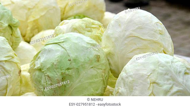 picture of Group of fresh harvested cabbages for sale at a farmer market