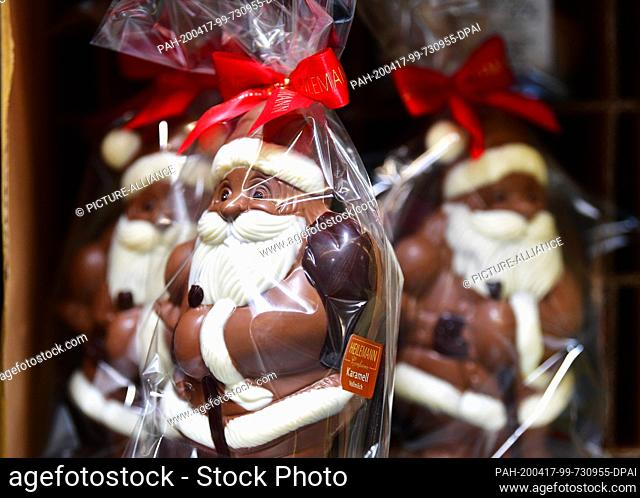16 April 2020, Brandenburg, Großbeeren: Chocolate Father Christmases wrapped in plastic foil are available at the logistics service provider Rhenus Warehousing...