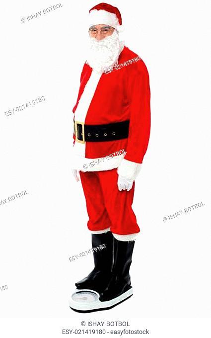 Health conscious Santa checking his weight