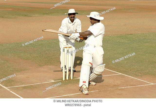 Indian left handed batsman in action playing hook shot in cricket match MR705I