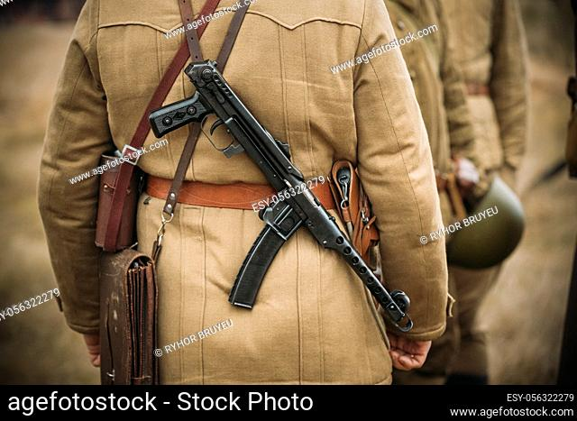 Re-enactor Dressed As Russian Soviet Infantry Soldier Of World War II With Sub-machine Gun Weapon. Red Army Soldier Of WWII WW2 Times