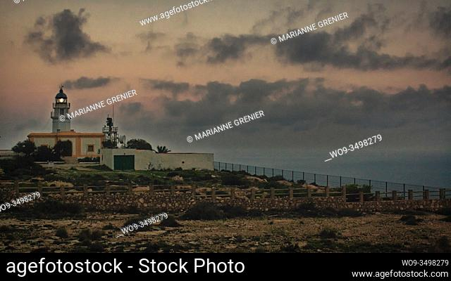 Mesa Roldan's lighthouse at sunset with grain vintage analog look, Carboneras, Almeria, Spain