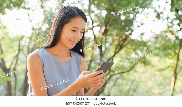 Chinese woman use of mobile phone